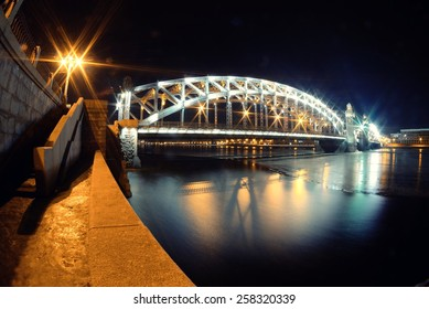 Bolsheokhtinsky Bridge through the Neva River in St. Petersburg in the winter night - Shutterstock ID 258320339