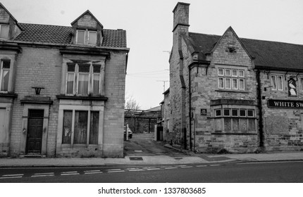 BOLSOVER, DERBYSHIRE, UK - MARCH 20, 2019: Derelict buildings in Bolsover, an old mining town in Derbyshire, England.