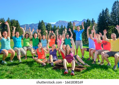 Bolsterlang, Bavaria, Germany, 10-19-2914, People doing teambuilding exercise, jubilating while sitting in sunny nature