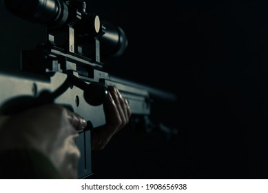 Bolt action sniper rifle and black background