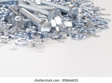 bolt nut and washer on light background