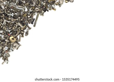 bolts, nuts, screws, washers on a white background located in the upper  left corner of the image, in the center free space for text.Flat lay