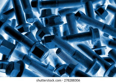 bolts piled up together, closeup of photo