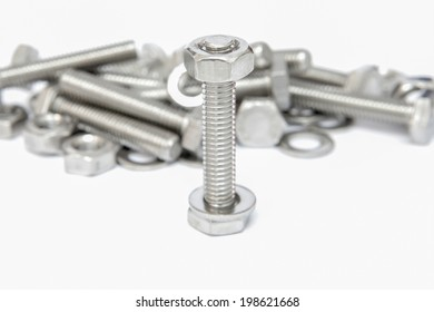 Bolts, screws, nuts isolated on white