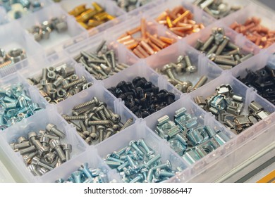 Bolts, screws, nuts, rivets on a counter of shop. Retail
