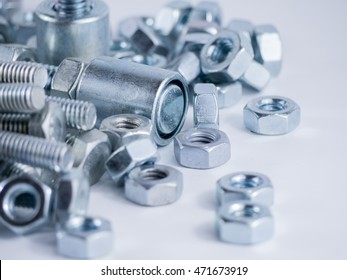 Bolts and screws on a white background. Bolts and screws used in construction. Tightening around the neck. Bolts and screws are descendants of mainly made of fine steel. Bolts and screws in isolate.