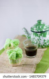 Bolu Kukus Pandan or pandan steamed cupcake, an Indonesian traditional sweet snack made of egg, flour, sugar, Pandan juice and soda, very fluffy and soft texture. It is steamed until cracks on top.