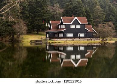 Bolu, Turkey - February 24, 2018: Lake house in Bolu Abant lake with a reflection.