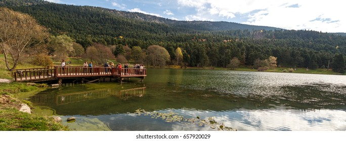 BOLU, TURKEY - NOVEMBER 5, 2016 : People watching around the lake. Golcuk National Park is touristic place in Bolu.