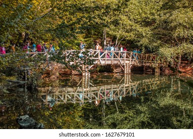 Bolu, Turkey - October 12, 2019: Tourists on wooden bridge at Yedigoller National Park on a sunny day.