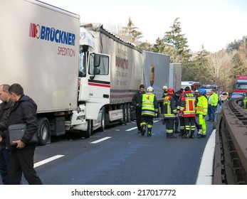 BOLZANO, APRIL 6, 2014: Multiple lorry road accident between four trucks on highway road. Trucks collision with injured motorists and truckers and intervention of paramedics on Bolzano, April 6, 2014