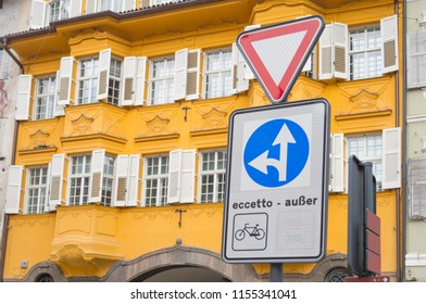 """Bolzano the bilingual city: traffic sign reading """"except"""" in Italian and German respectively in the historic city center of Bolzano, South Tyrol, Italy"""
