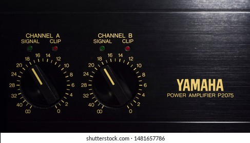 Bolzano, Italy, 18 August 2019: The gain controls of the Yamaha P2075 professional power amplifier, with green signal indicator and red clip indicator LEDs for each channel