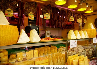 BOLZANO, ITALY - JUL 26, 2018 - Parmesan and 0ther cheeses for sale in the market of Bolzano, Italy