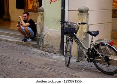 BOLZANO, ITALY - JUL 26, 2018 - Bicycle on  the narrow cobbled street of Bolzano, Italy