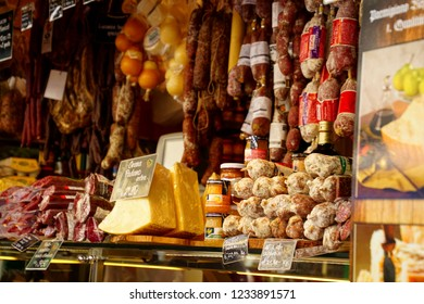 BOLZANO, ITALY - JUL 26, 2018 - Shoppers find meat,cheese and fresh vegetables  at an outdoor market in Bolzano, Italy