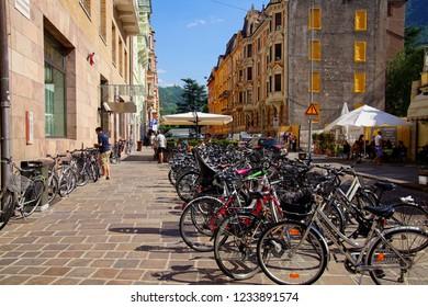 BOLZANO, ITALY - JUL 26, 2018 - Bicycles parked on street in Bolzano, Italy