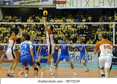 BOLZANO, ITALY - MARCH 27: Grzegorz Lomacz plays the ball during CEV Volley Champions League 2010/2011 classification match 3/4, Jastrzebski Wegiel vs Dinamo Moscow, in Bolzano on March 27, 2011