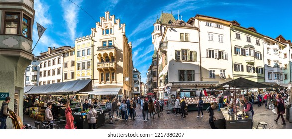 Bolzano, italy - October 19: People shopping at a famous Market Square in the old town at october 19,2018 in Bolzano in italy