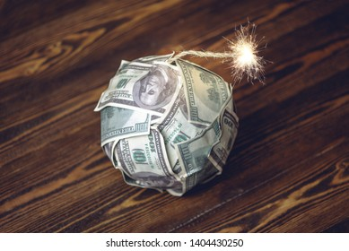 A bomb of money like dynamite, hundred-dollar bills with a burning fuse. Waiting for the explosion of investment markets. The concept of the financial crisis
