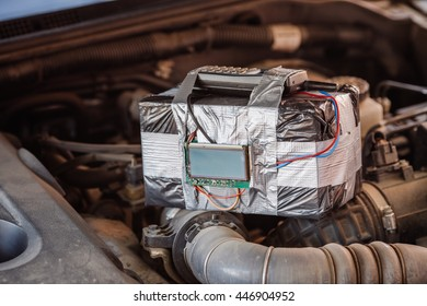 bomb with radio control and digital countdown timer on a car engine. terrorism and dangerous life concept