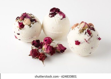Bomb salt bath decorated with dried roses on a white background