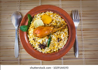 Bombay biryani, Top shot of Spicy Chicken Biryani, Indian traditional food in desk pot or Pakistani food in bowl.