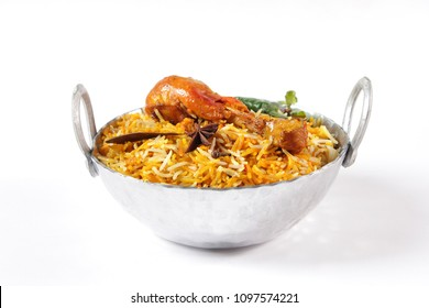 Bombay biryani, Traditional spicy indian food, Spicy chicken biryani in silver karahi dish, Iftar meal, Ramadan dinner.