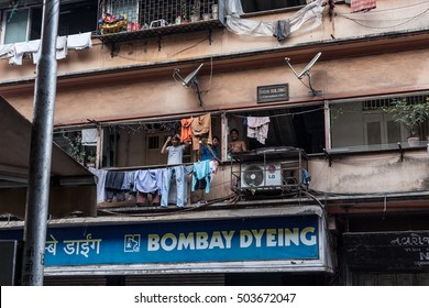 BOMBAY, INDIA, CIRCA NOVEMBER 2014. Three young man get ready to go out from their flat in Bombay.