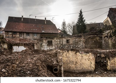 Bombed and destroyed houses with a lot of debris everywhere