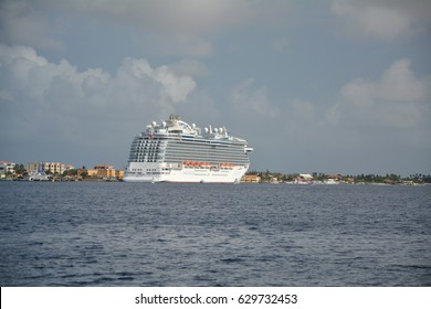 BONAIRE, CARIBBEAN - MARCH 26, 2017 : Royal Princess ship docked in Kralendijk port. Royal Princess is operated by Princess Cruises line and has a capacity of 3600 passengers
