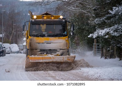 BONAR BRIDGE, SCOTLAND, UK - Feb 28, 2018: A snow plough at work in Bonar Bridge in Sutherland Scotland UK as the Beast of the East continues to cause heavy snow across much of the UK