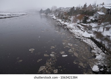 BONAR BRIDGE, SCOTLAND, UK - March 2, 2018: Pancake ice floats out on the tide in the Kyle of Sutherland river in the Dornoch Firth, Scotland, UK on March 2, 2018 during the 'Beast of the East' storm