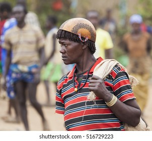 BONATA VILLAGE, OMO VALLEY. ETHIOPIA - JANUARY 2, 2014: Unidentified Ari woman in calabash hat (helmet) at local village market.