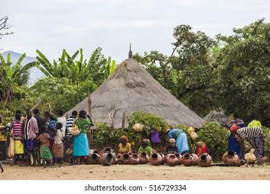 BONATA VILLAGE, OMO VALLEY. ETHIOPIA - JANUARY 2, 2014: Unidentified people at Terracotta pots stalls at local village market.