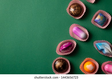 Bonbons set from above on green