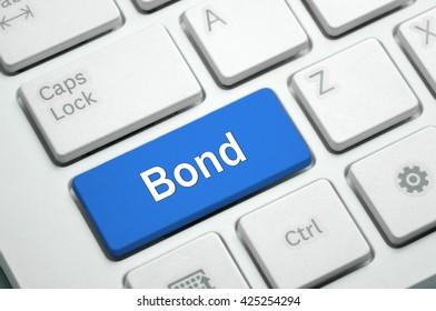 Bond text written on Blue button White Keyboard
