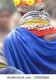 Bonda tribal woman with elaborate necklaces and earrings weekly market on Nov 12, 2009 in Ankadeli, Orissa in India