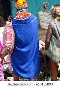Bonda tribal woman with elaborate necklaces and earrings weekly market  in Ankadeli, Orissa in India