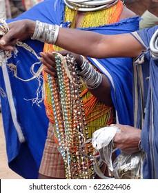 Bonda tribal women offer their handmade crafts at the  weekly market on Nov 12, 2009 in Ankadeli, Orissa in India