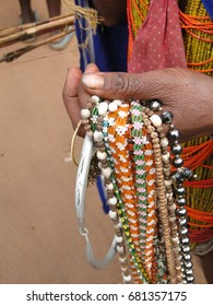 Bonda tribal women offer their handmade crafts to western tourists at the weekly market  in Ankadeli, Orissa in India