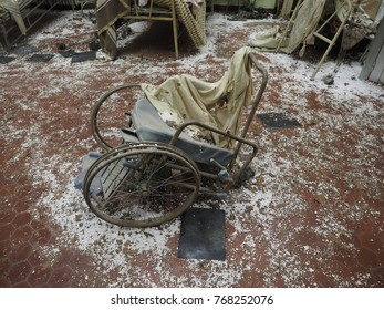 "Bondeno, Italy - December 2, 2017. Art installation ""The silent scream of Chernobyl"".  Reconstruction of the civil hospital after the atomic tragedy.  Wheelchair."