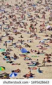 Bondi Beach, Australia-Dec 2019: high angle vertical view of Bondi Beach packed with people on a warm and sunny day
