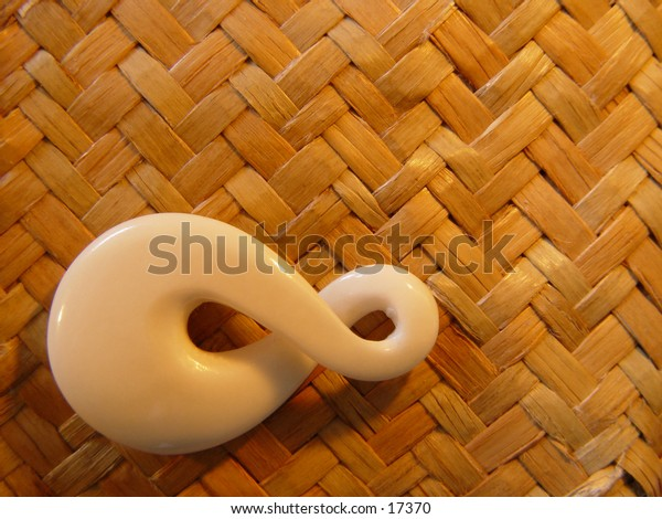 Bone carging against a woven flax background