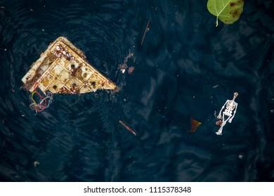 Bone doll and basket Plastic waste on the sea . plastic pollution.Envrionmental problem - plastics contaminate seafood