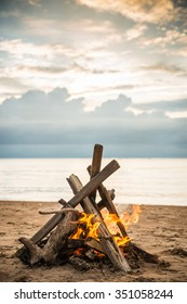 Bonfire at the beach in the evening sun