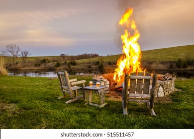 Bonfire in a firepit at sunset in Central Kentucky countryside near Georgetown.