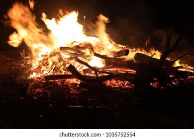 Bonfire flames burning wood closeup