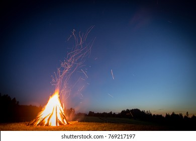 Bonfire at night with sparks