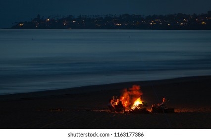 A bonfire on the beach with family and friends at night with the ocean view is a great memory